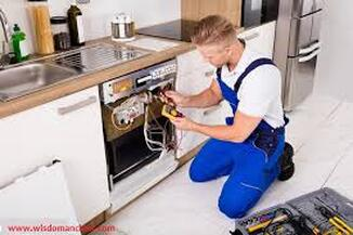 Electricians installing dishwasher