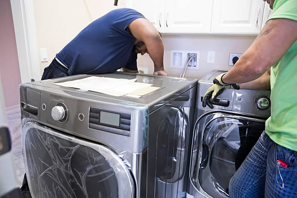 Electrician installing wash machine