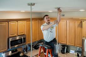 Electricians installing lighting
