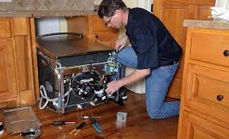 Electrician fixing dishwasher